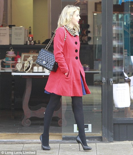 Covering up: Lydia hid her injuries under a pair of thick black tights as she popped into her store Bella Sorella in Loughton yesterday