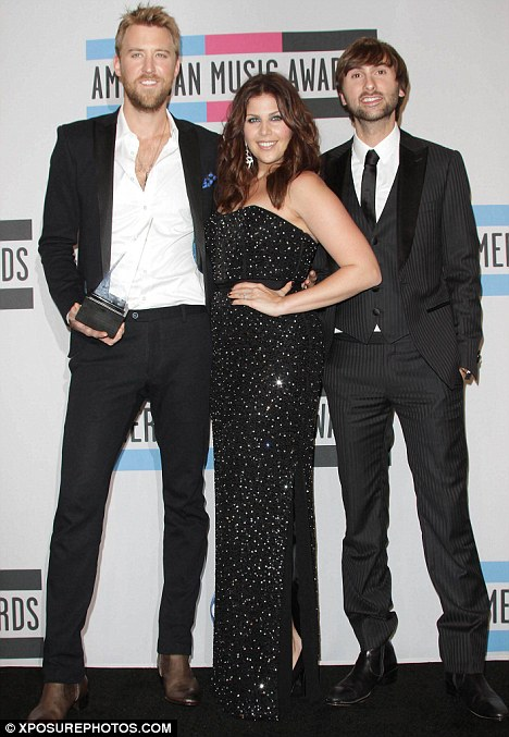 No shows: Hilary's Lady Antebellum bandmates Charles Kelley, left, and Dave Haywood did not attend the intimate ceremony but are said to be looking forward to celebrating with her soon