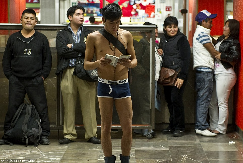 Travelling light: In Mexico City, a man went out wearing just a necklace, underpants and boots while others try to ignore him