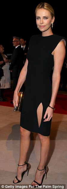 Walking tall: The event was held at the Palm Springs International Film Festival, seen right last night walking the red carpet in a slit black dress