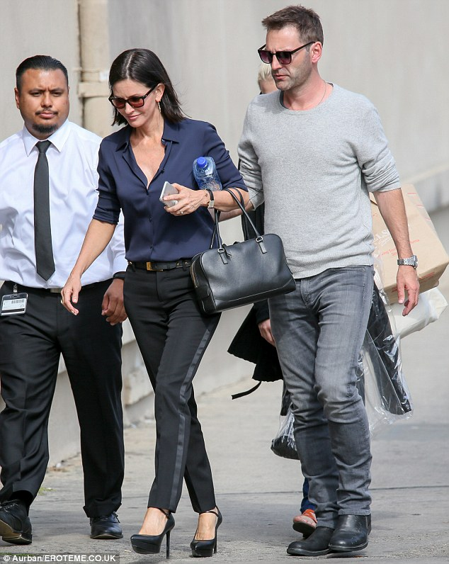 OUt and about: The Cougar Town star and her 38-year-old fiancé, pictured in Hollywood in April, have been together since late 2013 and got engaged in June 2014