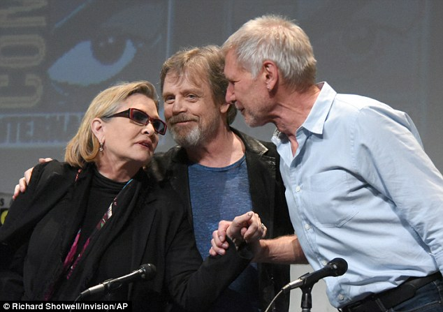 Lurking:Fittingly (if creepily), Carrie and Harrison's co-star Mark Hamill embraced them as they publicly displayed their affection
