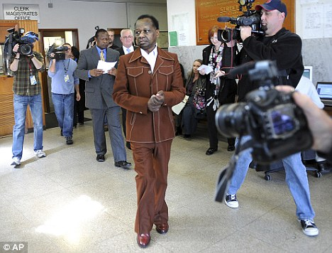 Charged: Onyango Obama is pictured here leaving Framingham District Court after his court appearance in March