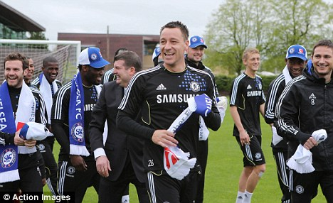 All smiles: Terry in Chelsea training on Thursday ahead of their final league game