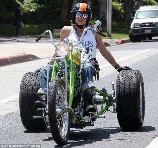Showing off: Steven Tyler took his ostentatious chopper motorbike for a ride around West Hollywood yesterday
