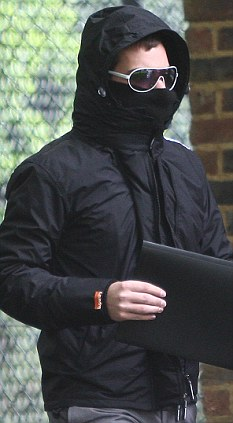 Undercover: Former British Airways steward Mathew Davis wore large sunglasses and a hooded jacket pulled over his face on his way to Isleworth Crown Court