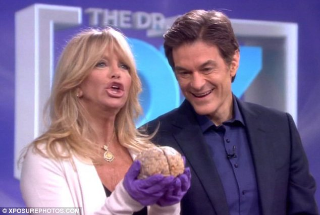 Slimy: Hawn was very hands on with the organ, to the amusement of host Dr. Oz