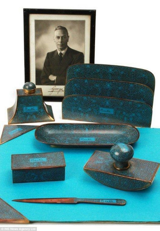 Valuable: The turquoise set includes a letter rack, an ink well, roller blotter, pen tray, paper knife,and stamp box, each with the the king¿s nickname, Bertie, engraved on it