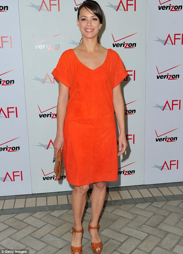 Winning: The Artist actress Berenice Bejo looked striking in a simple bright orange dress and open toe sandals