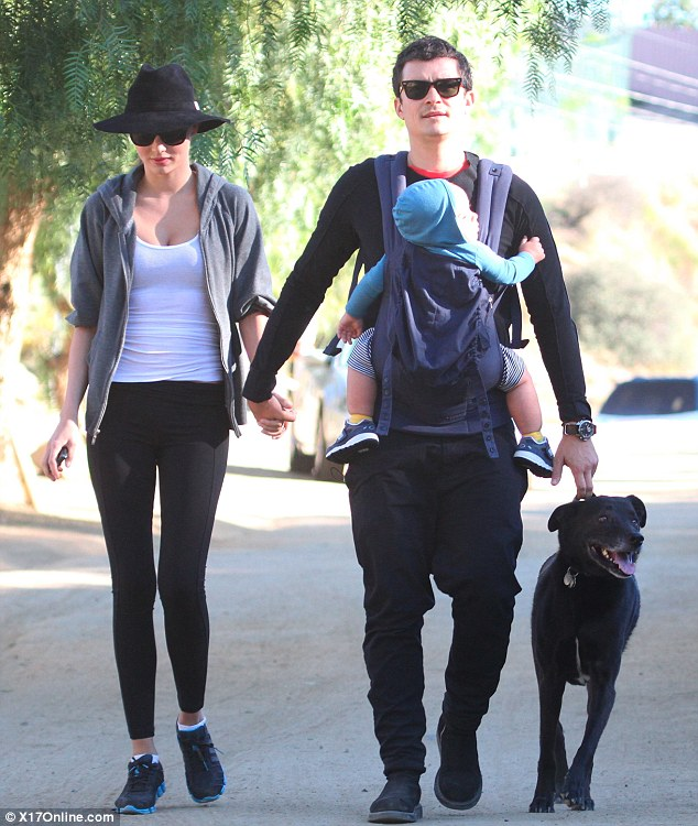 Picture perfect: Orlando went for a walk with his son Flynn, his wife Miranda Kerr and their dog