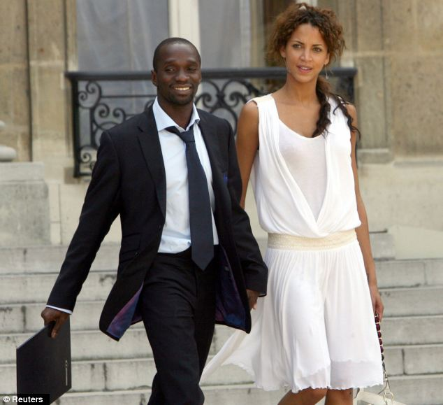 Outwardly relaxed: Makelele and his former girlfriend and mother of his son, model Noemie Lenoir, leave the Elysee Palace in Paris in 2006