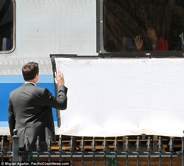 Tender: Rachel and Finn are the left to share a wave and a look of longing before the train departs