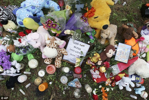 'God bless this little boy': A memorial site is seen near the spot where the young boy's body was found last Saturday