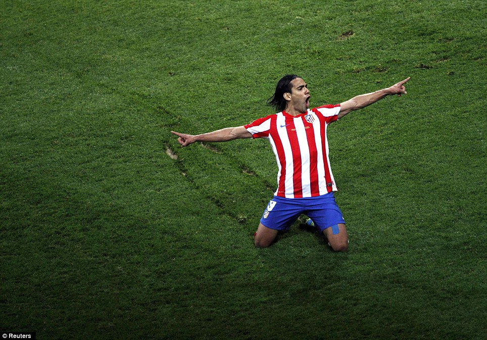 Atletico Madrid striker Falcao celebrates after scoring against Athletic Bilbao in the Europa League final in Bucharest