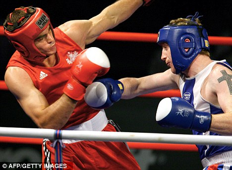 Medal: Kenny Anderson (right) won his Commonwealth title in 2006