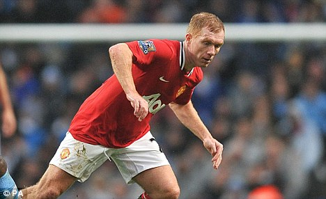 Back in action: Ferguson offered a new contract to Paul Scholes