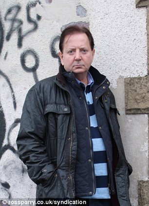 Back in his old neighbourhood: Mr King poses next to a graffiti-covered wall while he went undercover in the show