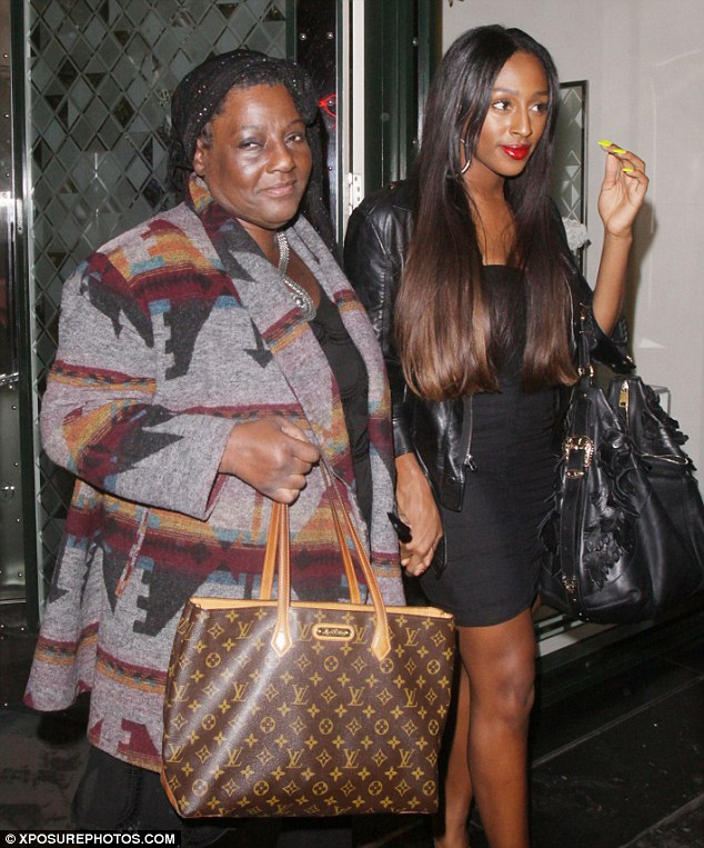Mother and daughter: The 23-year-old and her mother looked to be in good spirits as they left the restaurant