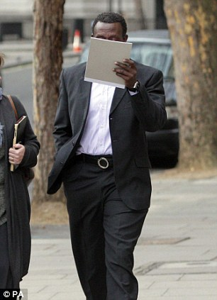 Lost: Former Olympic sprint champion Linford Christie covers his face
