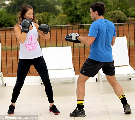 Handy: Natasha was recently put through her paces at the Number 1 Bootcamp in Ibiza, seen here with trainer Pete Collins