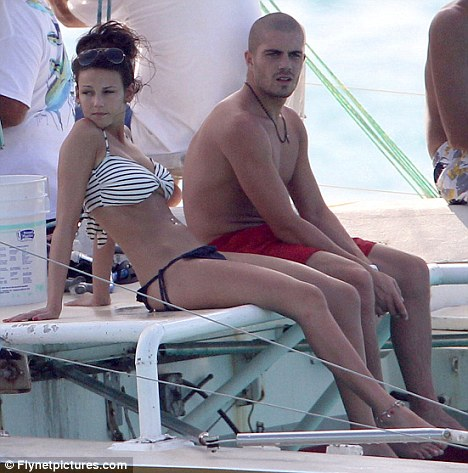 Picked up a tan: The star spent her Christmas break in Barbados with boyfriend Max George