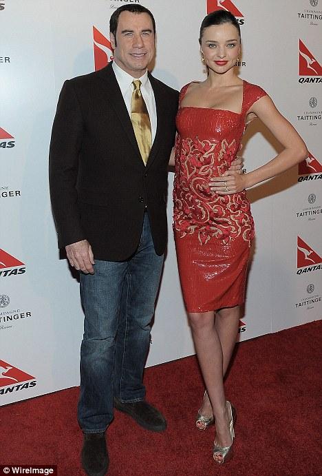 Sharing parenting tips: Travolta posed up with new Qantas ambassador Miranda Kerr at the event, held at the Hollywood Roosevelt Hotel