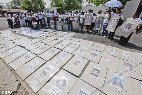 Retaliation: Protesters gathered showing pictures of those missing and ultimately believed in connection or retaliation to an abduction Tuesday that captured 12