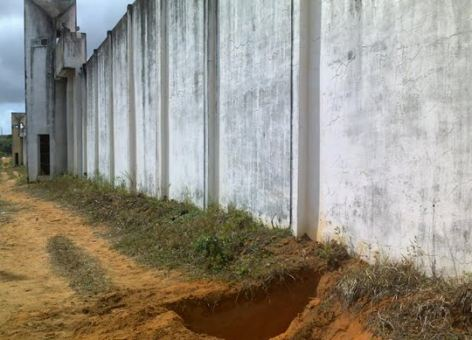 Gaping hole: Inmates spend all their time plotting escapes says the prison governor at this Brazilian jail. Here another tunnel is discovered just outside the walls