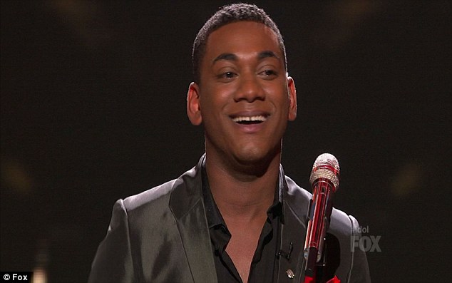 Clear favourite: Joshua Ledet was delighted at the standing ovation and plaudits he received after his powerful James Brown cover on American Idol tonight