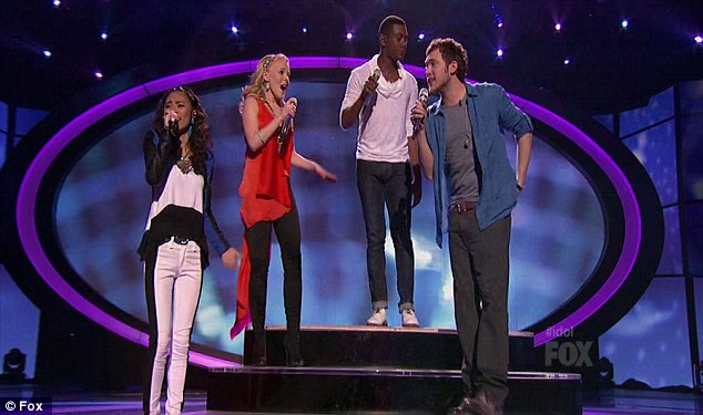 Four's a crowd: The remaining contestants took to the stage to perform Foreigner song Waiting For A Girl Like You