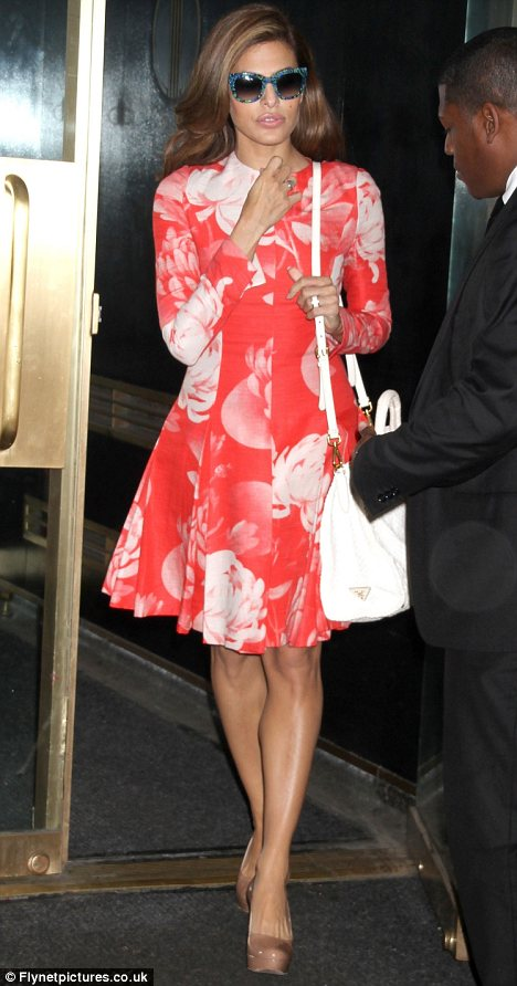 Swinging Sixties: Eva Mendes showed off some flower power in a floral swing coat