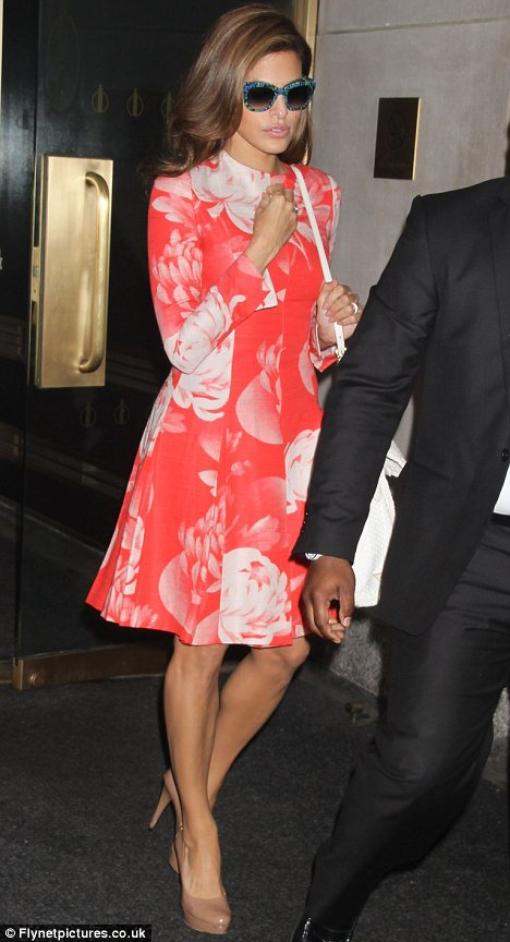 Leggy lady: Eva accentuated her toned legs with the help of patent taupe pumps as she headed to the studios