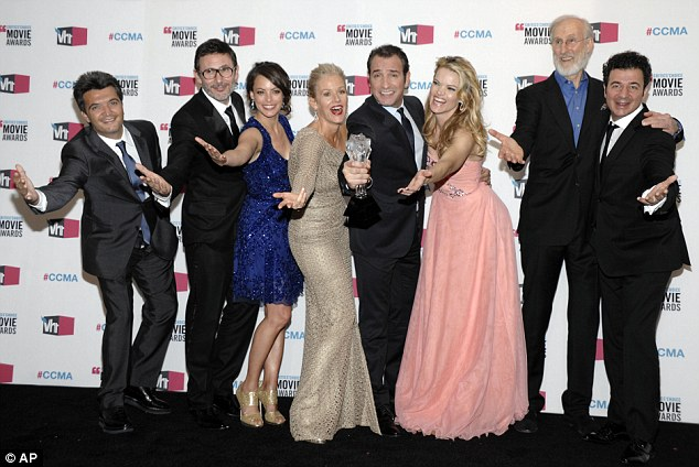 C'est magnifique! The cast of The Artist celebrate their quadruple win at the Critic's Choice Awards last night