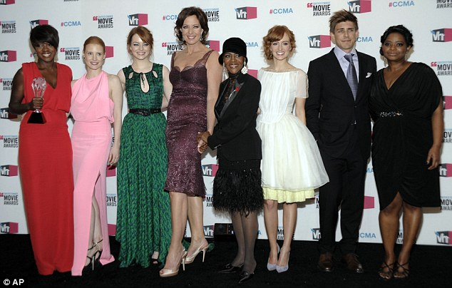 Southern victory: The cast of The Help pose for pictures after winning three awards at last night's bash