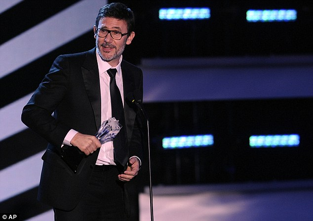 Merci beaucoup! The Artist director Michel Hazanavicius collects his award for Best Director for his silent movie masterpiece