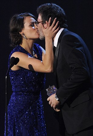 Bravo! The Artists's lead actress Berenice Bejo kisses Hazanavicius as he accepts his award while his producer Thomas Langmann thanks the crowd for the Best Picture award