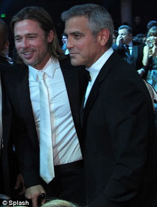 Dividing his time: George was as attentive as ever with girlfriend Stacey backstage, but there was some palpable bromance between him and Brad Pitt