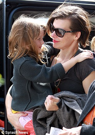 Mother and child: Despite being very late for their outbound flight, Milla and Ever shared a touching moment