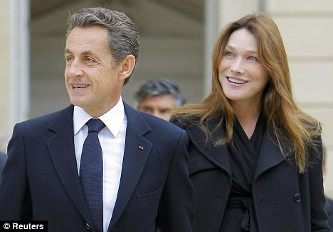 Superhuman: France's First Lady Carla Bruni (right) said her husband President Nicolas Sarkozy had 'superhuman' in dealing with his job