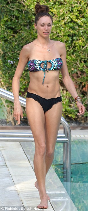 Bikini body: Lilly Becker showed off her enviable frame -and a very pert bottom - as she relaxed by the pool in Miami