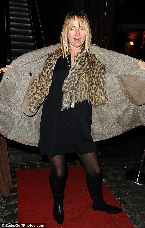 Bleary-eyed: Carol McGiffin flashed photographers... but thankfully was suitably covered up