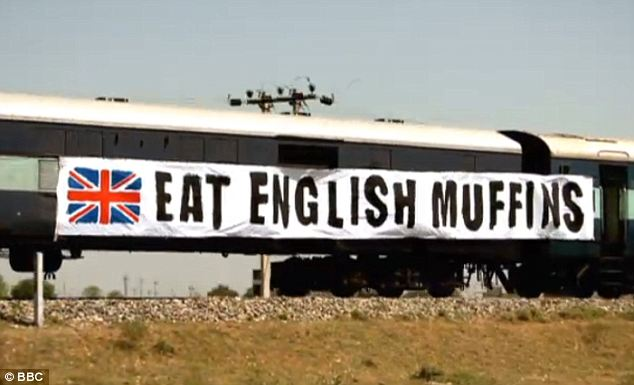 Rude: The Top Gear team attached this 'Eat English muffins' banner to the side of an Indian train