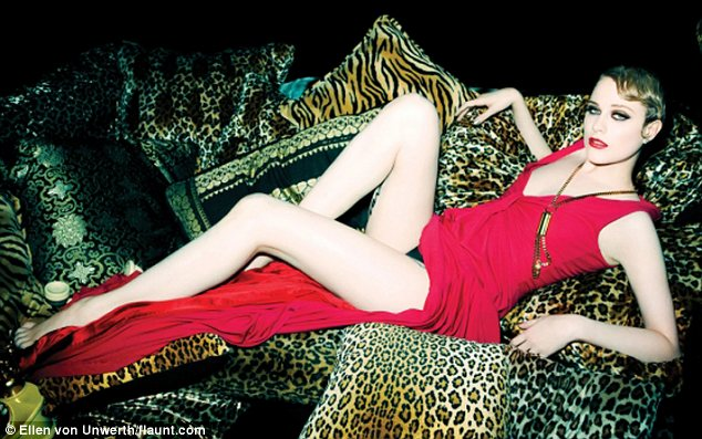 Lady in red: In on shot the Ides of March star poses in a long red dress but flashes her knickers