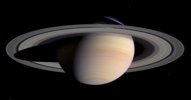 In orbit: Saturn takes 30 Earth years to complete each orbit around the Sun