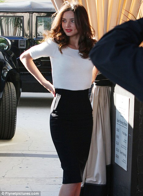 Pencil thin: The Australian model's black skirt showed off her slim figure to the maximum