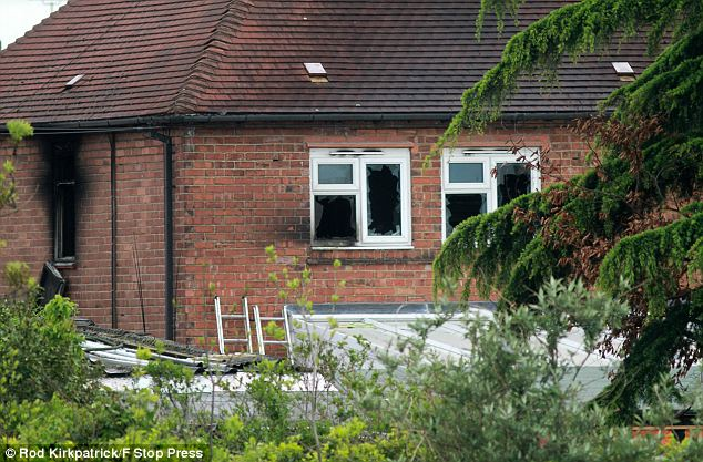 Tragedy: The scene in Victory Road, Allenton, Derby, where five children died and two adults were taken to hospital this morning after a fire