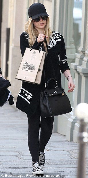 Incognito: The Canadian singer took to the streets of Paris in the all black ensemble, showing off another skull design on her leggings