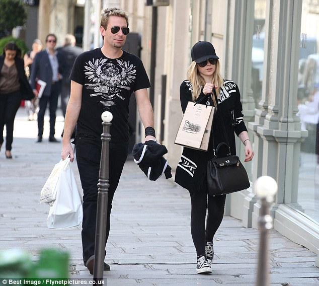 Retail therapy: Lavigne indulged in some shopping as she was joined by her friend, who also wore a dark get-up