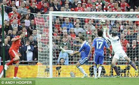 Close shave: Cech claws back Carroll's effort at Wembley