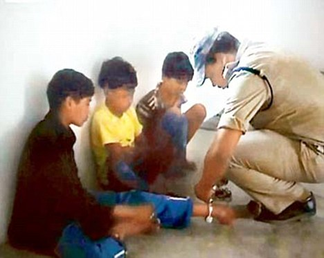 The boys were kept in shackles at the police station
